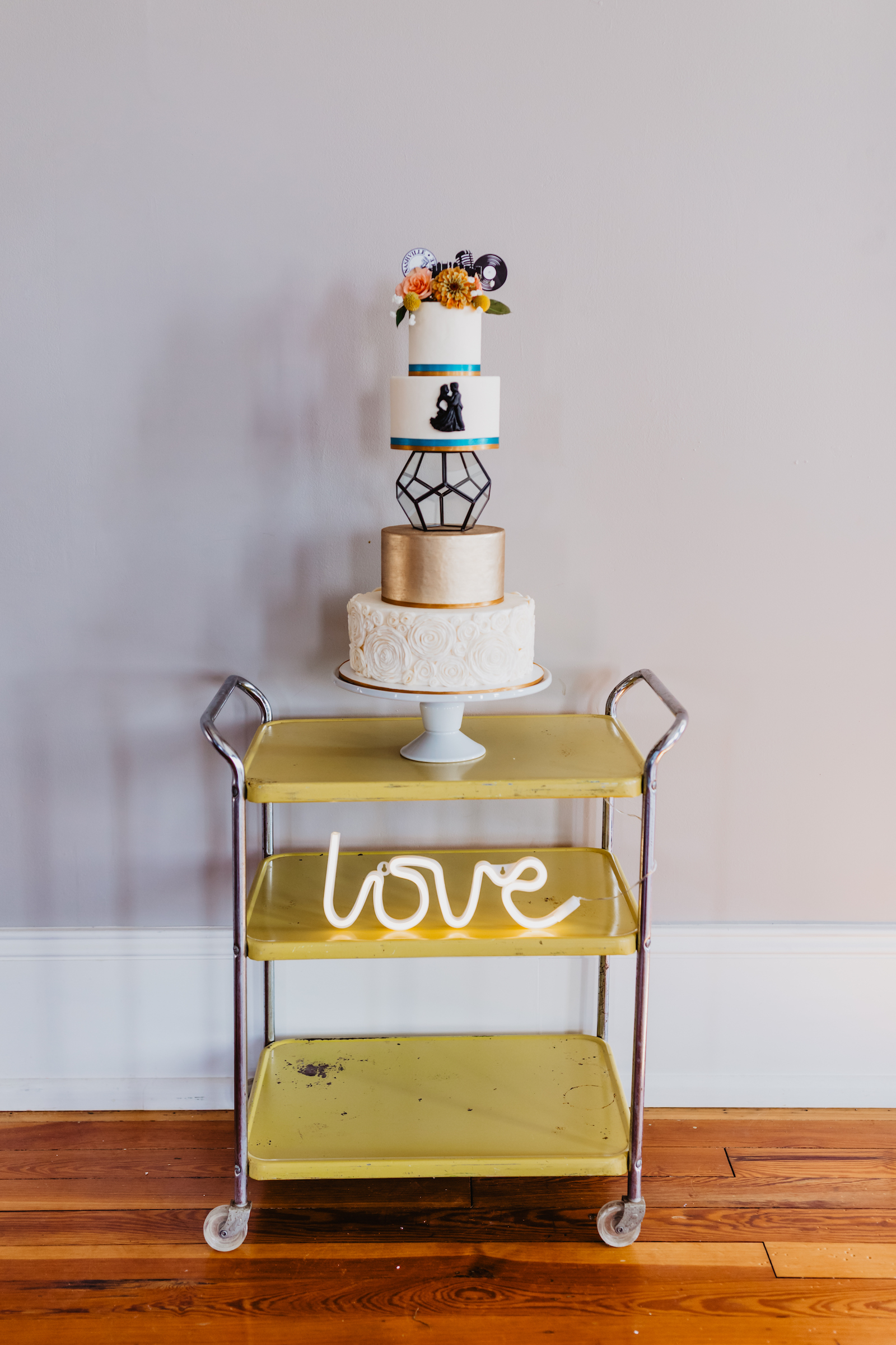 Wedding cake stand: Music City Merger Styled Shoot featured on Nashville Bride Guide