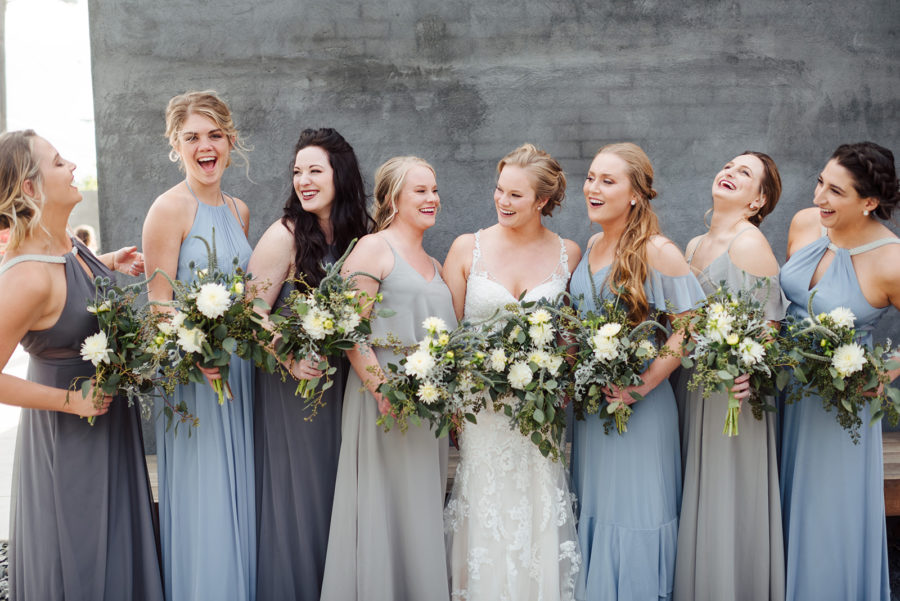 Mismatched blue and gray bridesmaid dresses: Nashville wedding at Clementine featured on Nashville Bride Guide