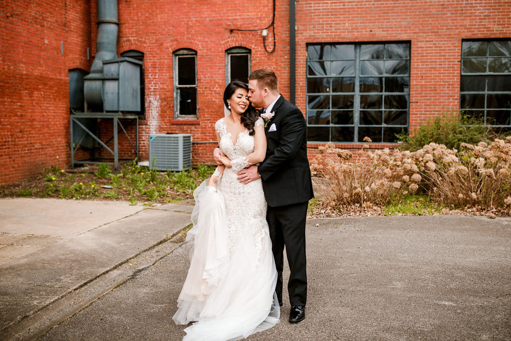 Bride and groom photos: Wedding at The Mill captured by John Myers Photography featured on Nashville Bride Guide