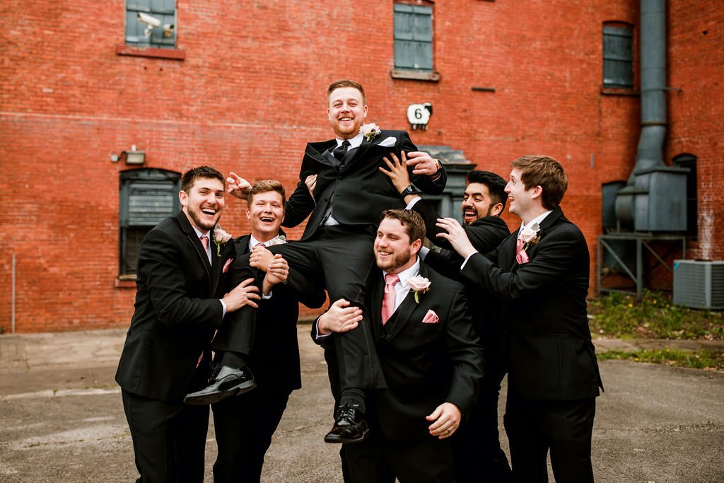 Groomsmen photo ideas: Wedding at The Mill captured by John Myers Photography featured on Nashville Bride Guide