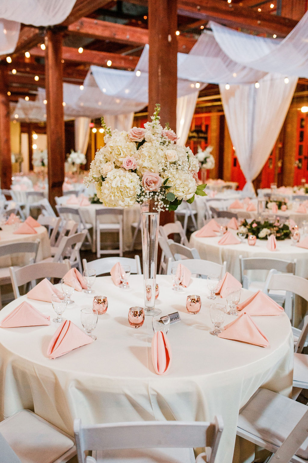 Tall pink and white floral wedding centerpieces: Wedding at The Mill captured by John Myers Photography featured on Nashville Bride Guide
