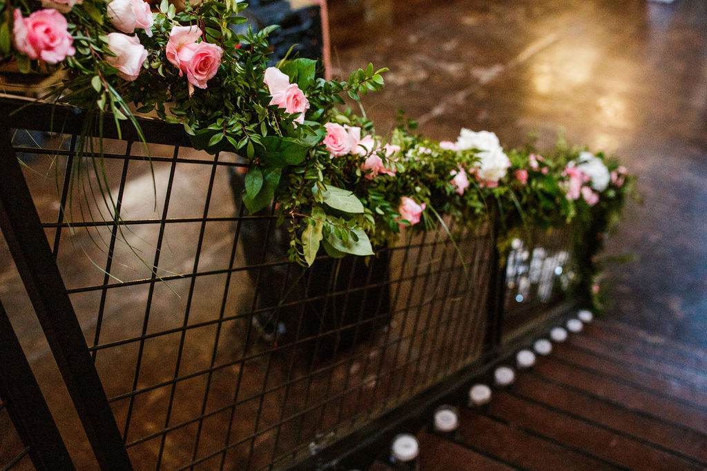 Pink floral wedding reception decor: Wedding at The Mill captured by John Myers Photography featured on Nashville Bride Guide