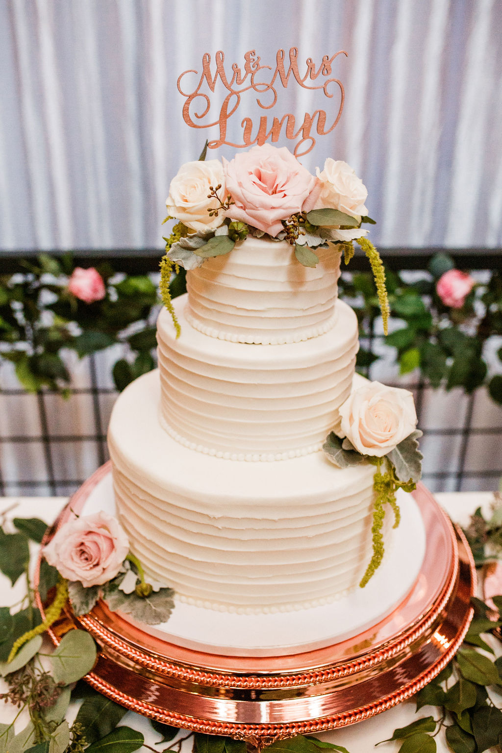 Ivory wedding cake with pink flowers: Wedding at The Mill captured by John Myers Photography featured on Nashville Bride Guide
