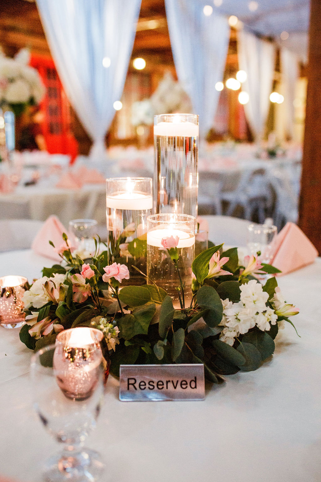 Candles and greenery wedding centerpieces: Wedding at The Mill captured by John Myers Photography featured on Nashville Bride Guide