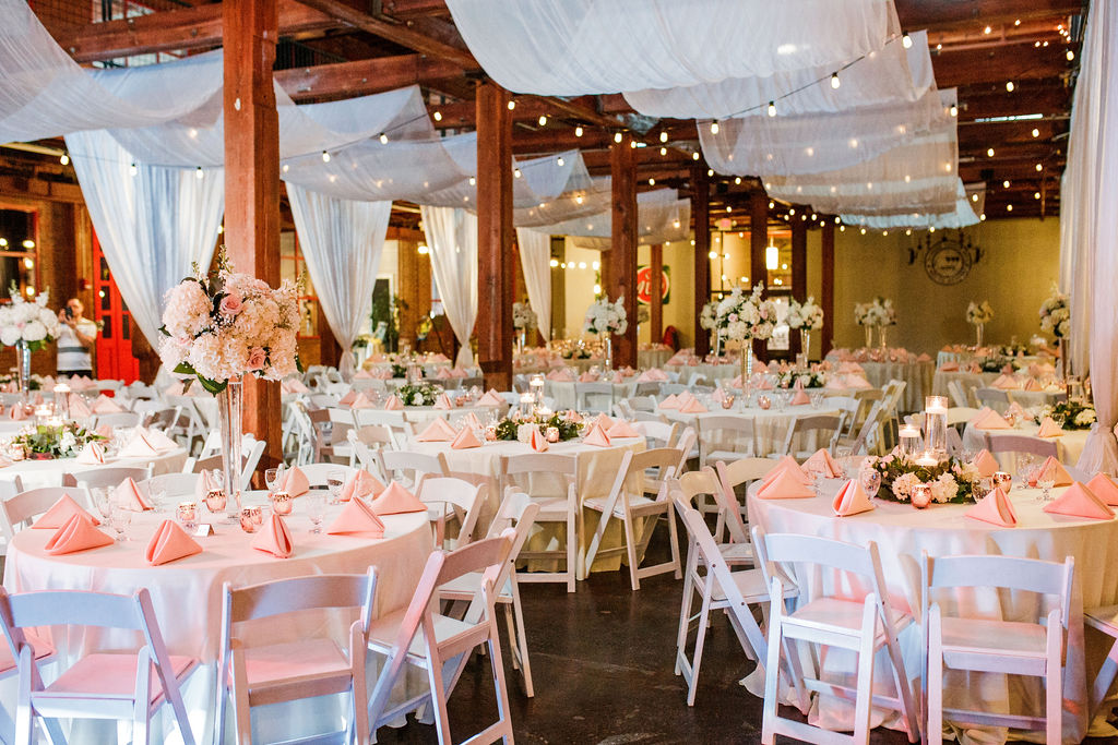 Pink, white, and greenery wedding reception decor: Wedding at The Mill captured by John Myers Photography featured on Nashville Bride Guide