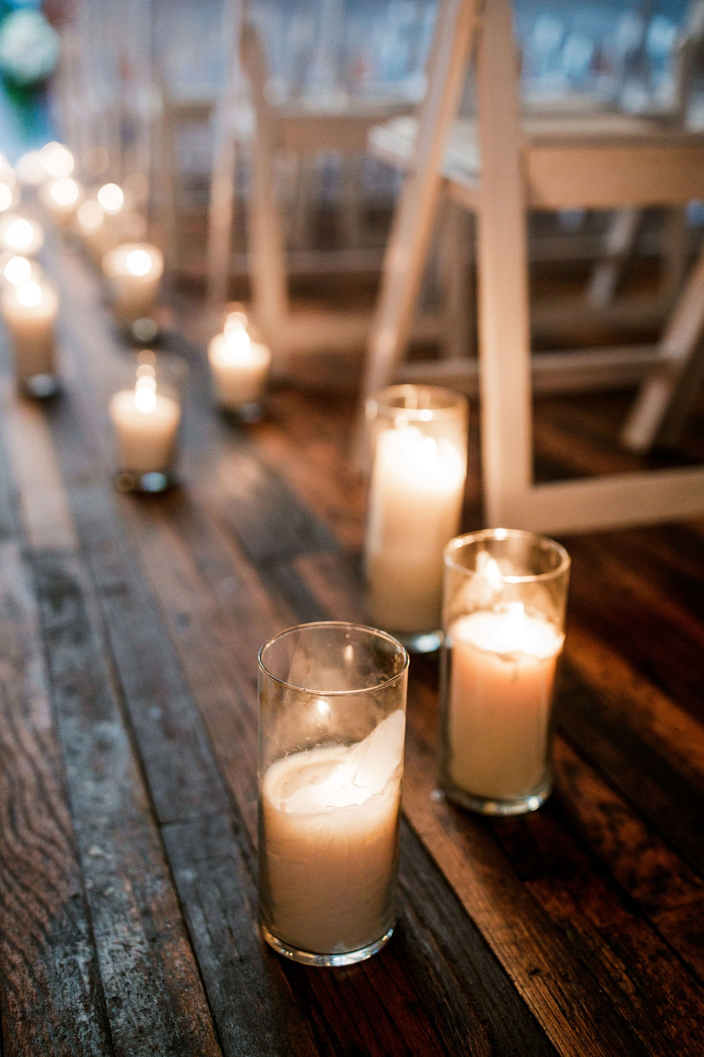 Candle wedding ceremony decor: Wedding at The Mill captured by John Myers Photography featured on Nashville Bride Guide