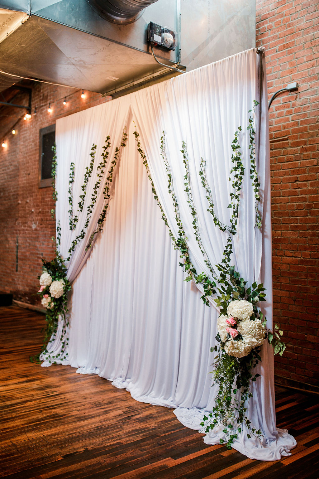 Wedding ceremony backdrop inspiration: Wedding at The Mill captured by John Myers Photography featured on Nashville Bride Guide