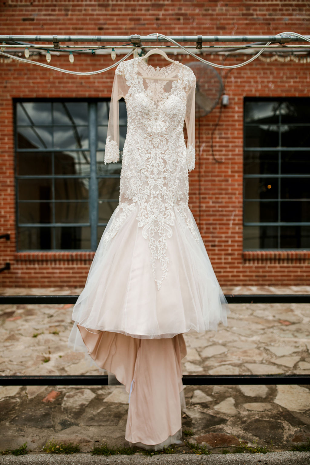 Fit and flare wedding dress: Wedding at The Mill captured by John Myers Photography featured on Nashville Bride Guide
