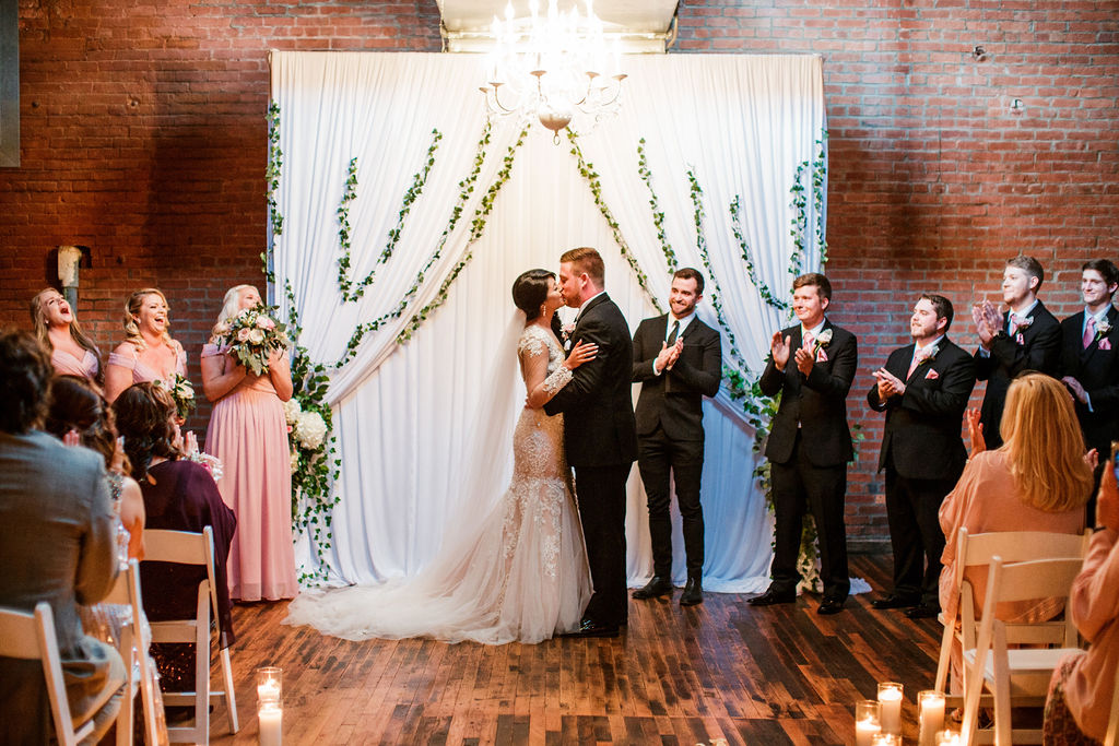 Bride and groom during wedding ceremony: Wedding at The Mill captured by John Myers Photography featured on Nashville Bride Guide
