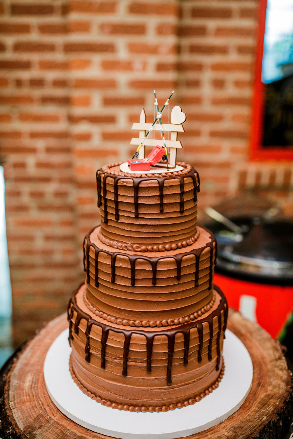 Chocolate drip wedding cake: Wedding at The Mill captured by John Myers Photography featured on Nashville Bride Guide