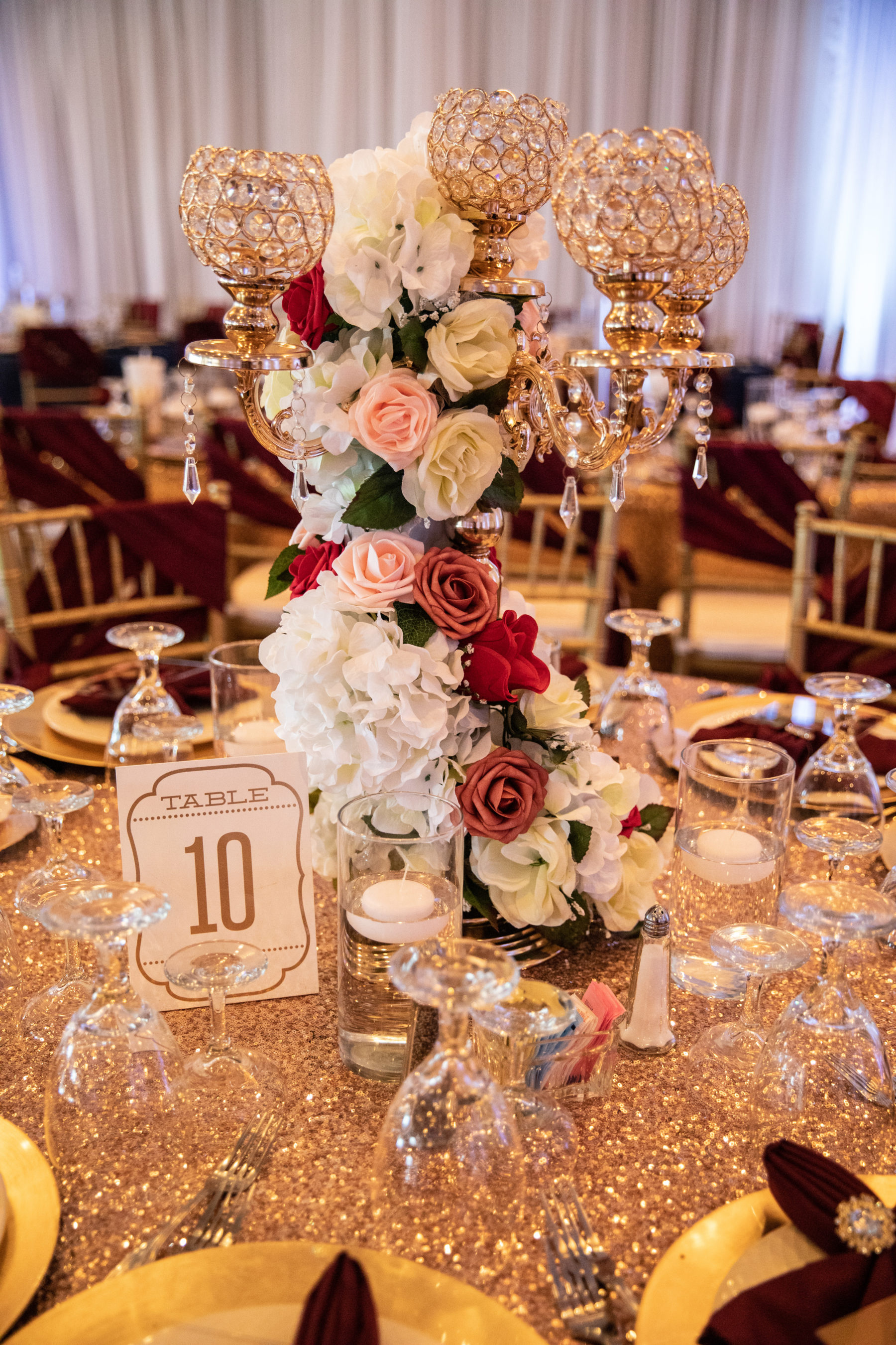 Tall lavish wedding centerpiece: Luxurious Stone Rivers Country Club Wedding featured on Nashville Bride Guide