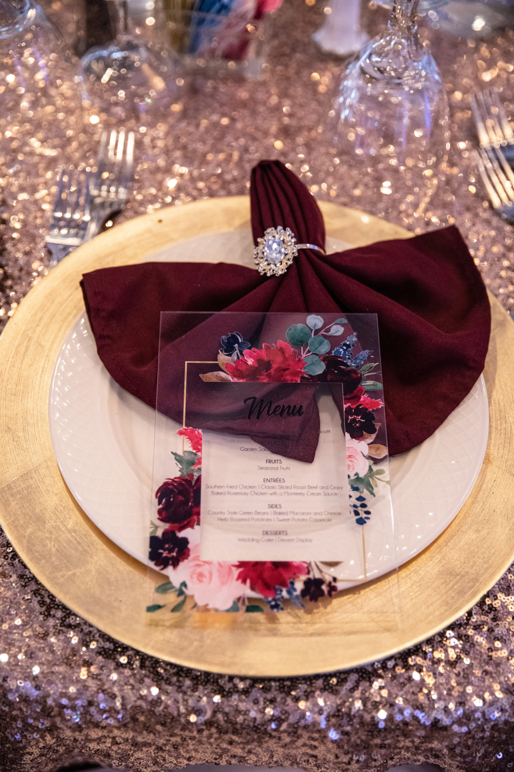Maroon and gold wedding place setting: Luxurious Stone Rivers Country Club Wedding featured on Nashville Bride Guide