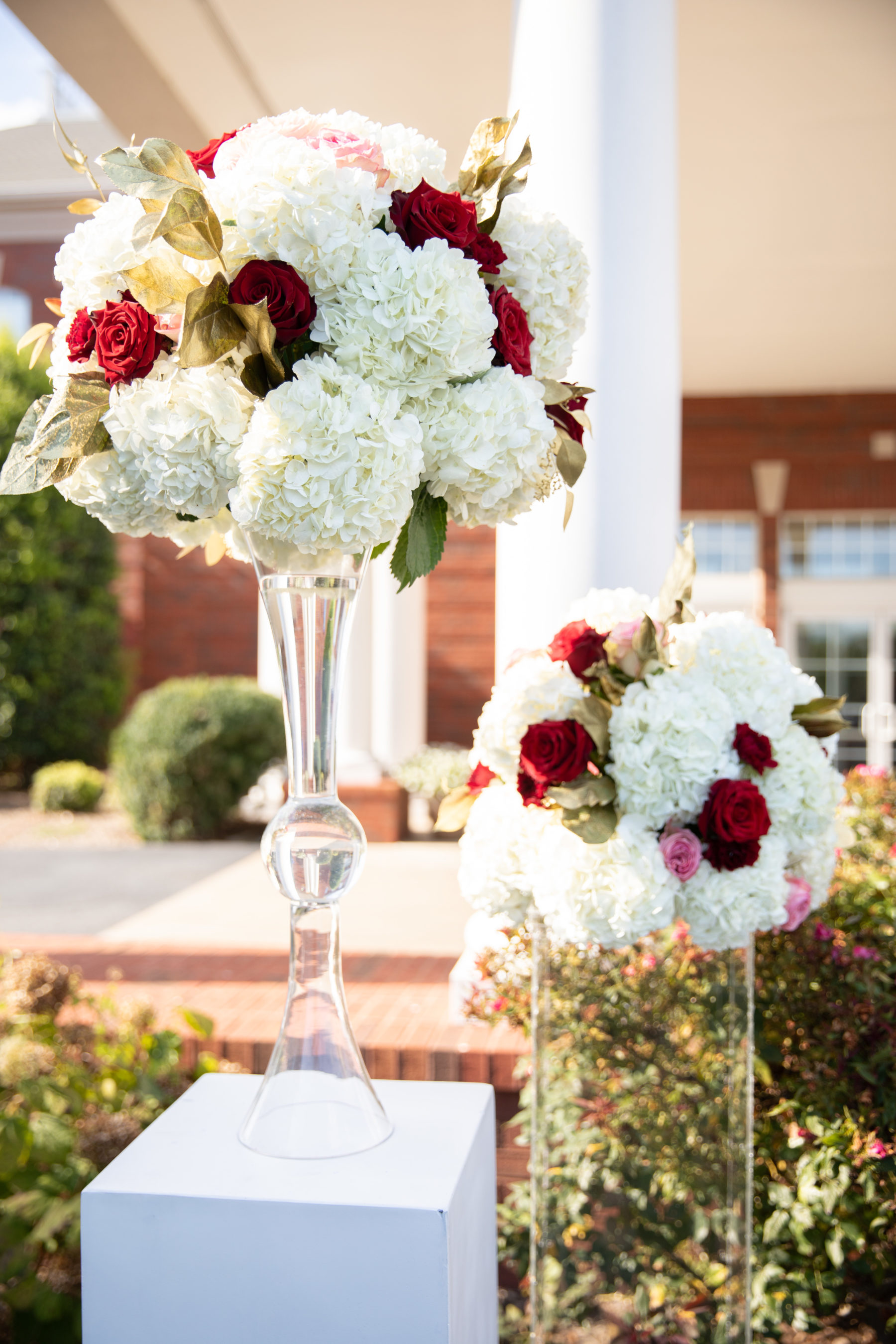 White and red wedding ceremony flowers: Luxurious Stone Rivers Country Club Wedding featured on Nashville Bride Guide
