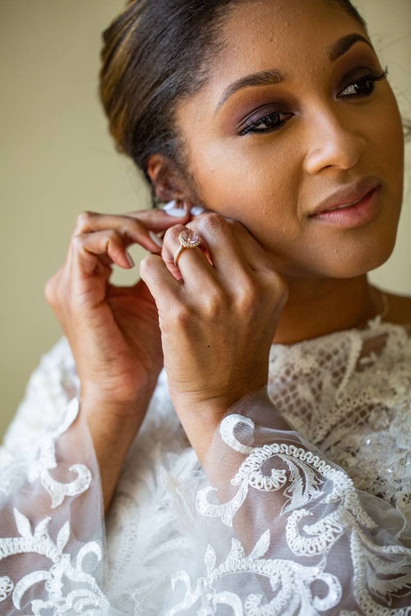 Bride getting ready: Downtown Hilton Nashville wedding captured by Sharon Theresa Wheaton Photography featured on Nashville Bride Guide