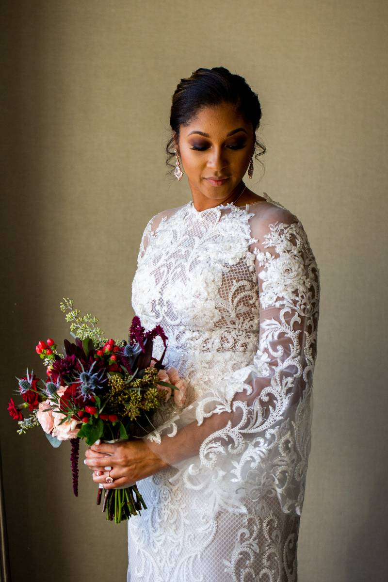 Bridal portrait with wedding bouquet: Downtown Hilton Nashville wedding captured by Sharon Theresa Wheaton Photography featured on Nashville Bride Guide