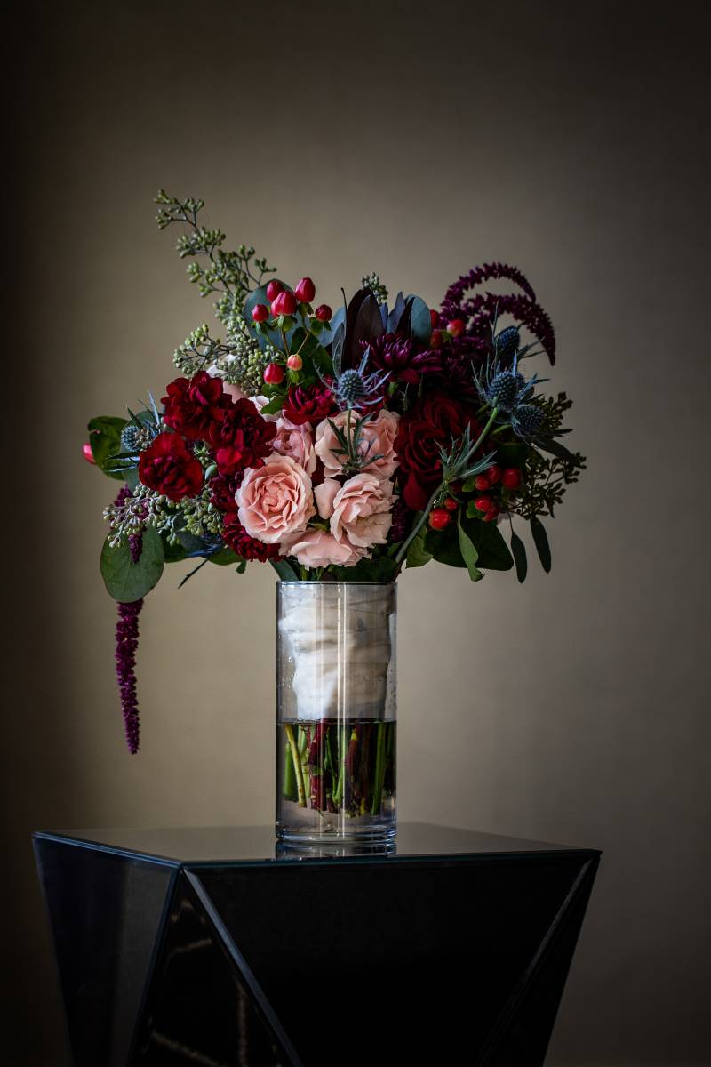 Burgundy and blush wedding bouquet: Downtown Hilton Nashville wedding captured by Sharon Theresa Wheaton Photography featured on Nashville Bride Guide