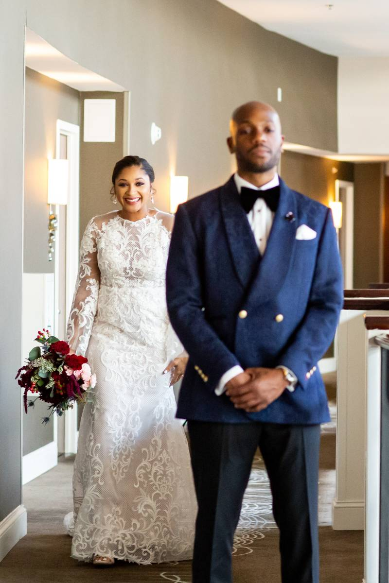 Wedding First Look: Downtown Hilton Nashville wedding captured by Sharon Theresa Wheaton Photography featured on Nashville Bride Guide