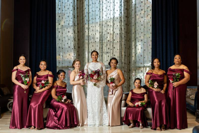 Burgundy bridesmaid dresses: Downtown Hilton Nashville wedding captured by Sharon Theresa Wheaton Photography featured on Nashville Bride Guide