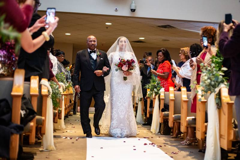 Bride walking down the aisle: Downtown Hilton Nashville wedding captured by Sharon Theresa Wheaton Photography featured on Nashville Bride Guide