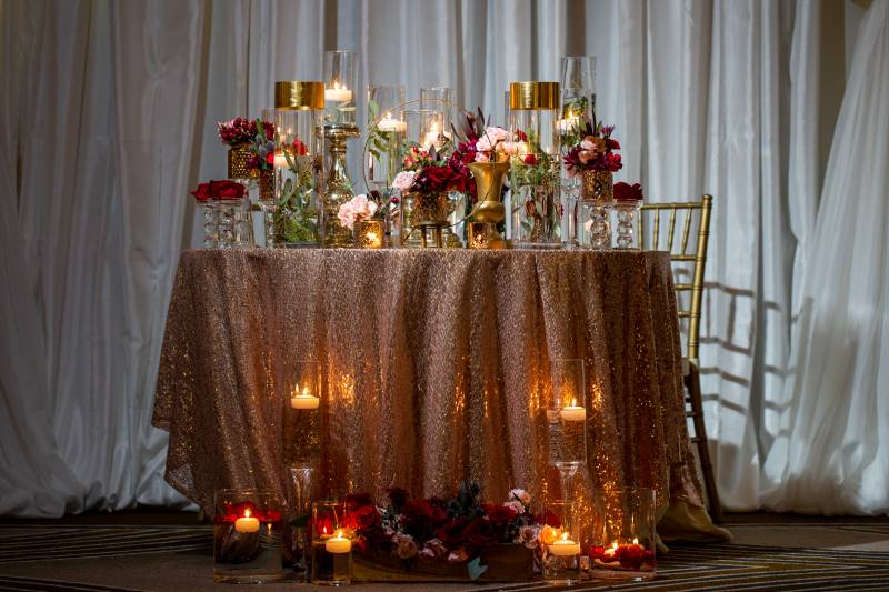 Wedding sweetheart table decor with rose gold linens: Downtown Hilton Nashville wedding captured by Sharon Theresa Wheaton Photography featured on Nashville Bride Guide