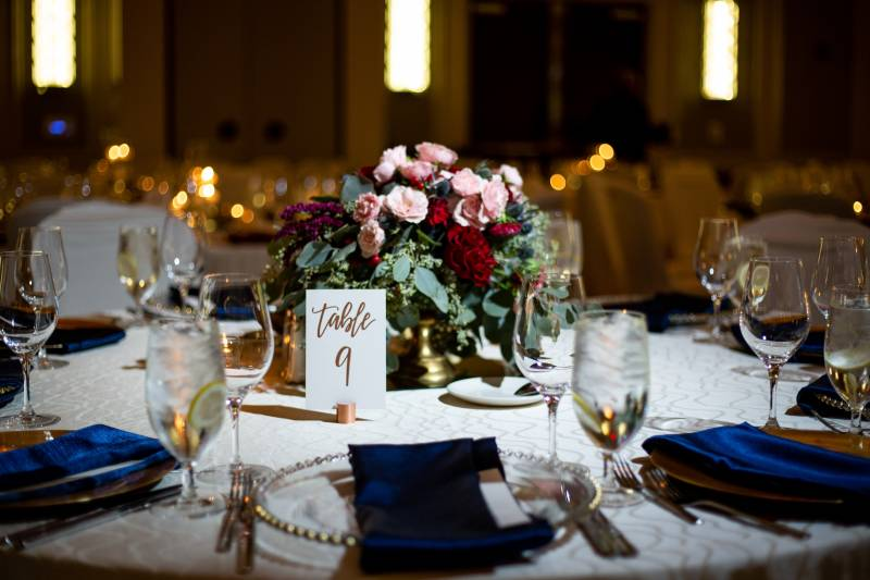 Red and blush wedding centerpieces: Downtown Hilton Nashville wedding captured by Sharon Theresa Wheaton Photography featured on Nashville Bride Guide
