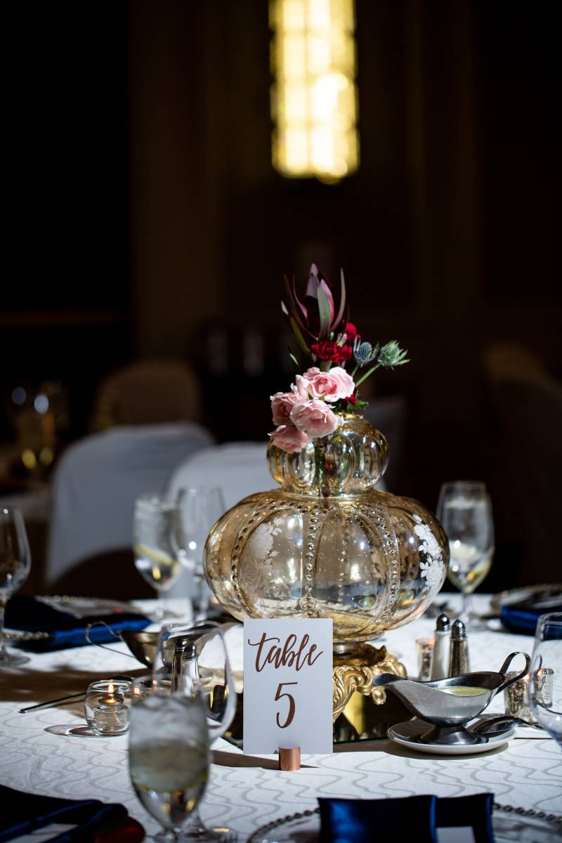 Low wedding centerpieces: Downtown Hilton Nashville wedding captured by Sharon Theresa Wheaton Photography featured on Nashville Bride Guide