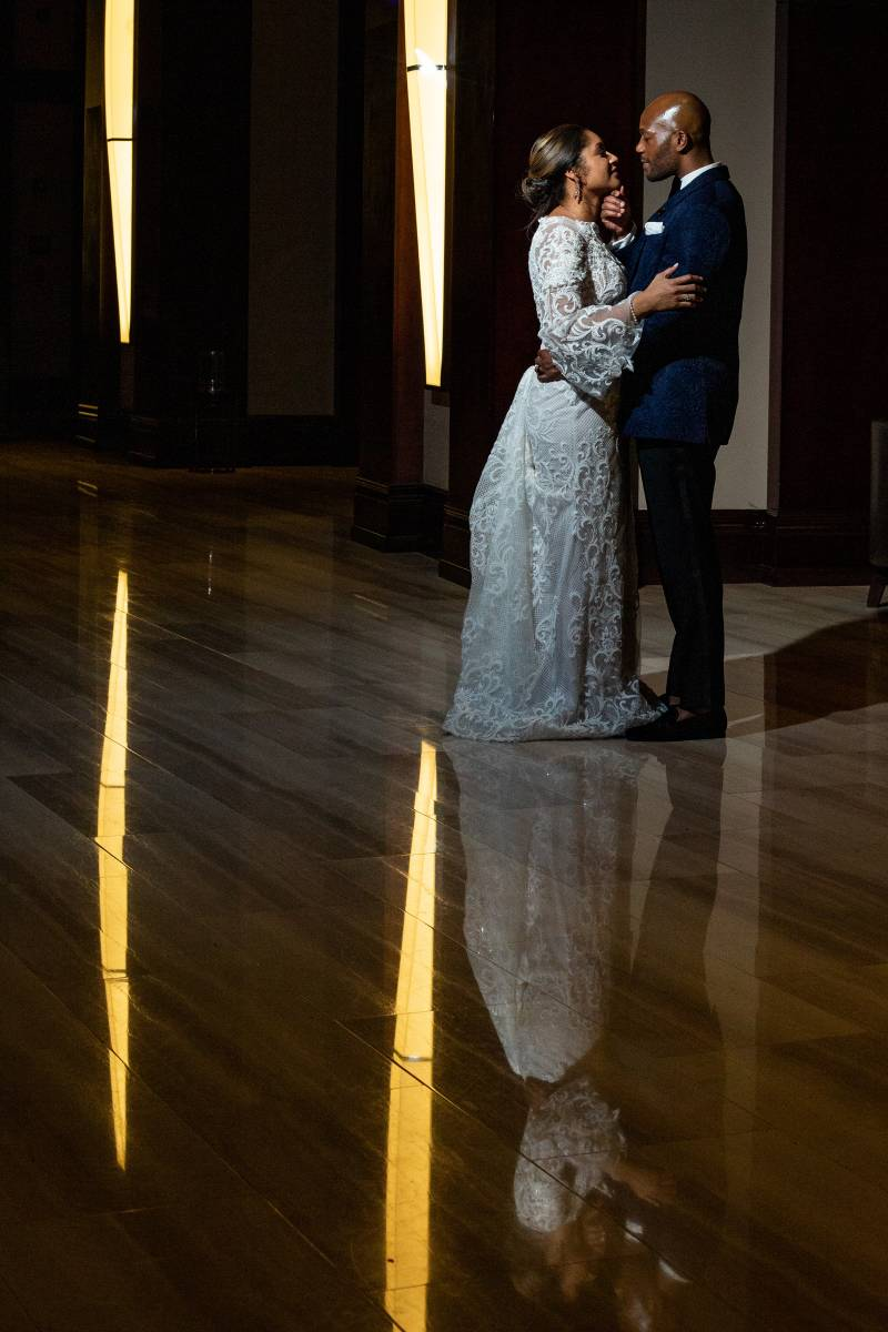 Bride and groom at wedding reception: Downtown Hilton Nashville wedding captured by Sharon Theresa Wheaton Photography featured on Nashville Bride Guide