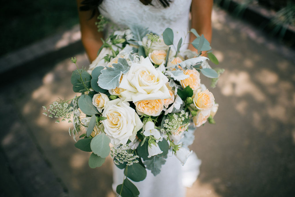 Orange and white wedding bouquet by FLWR Shop Nashville