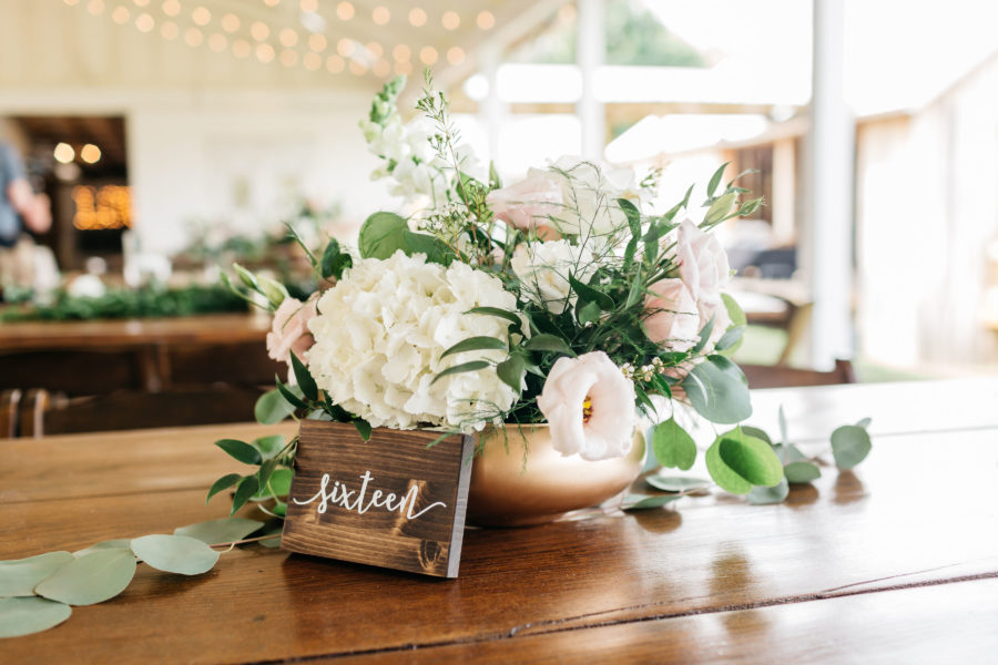 Wooden wedding table numbers: Rustic Front Porch Farms wedding featured on Nashville Bride Guide
