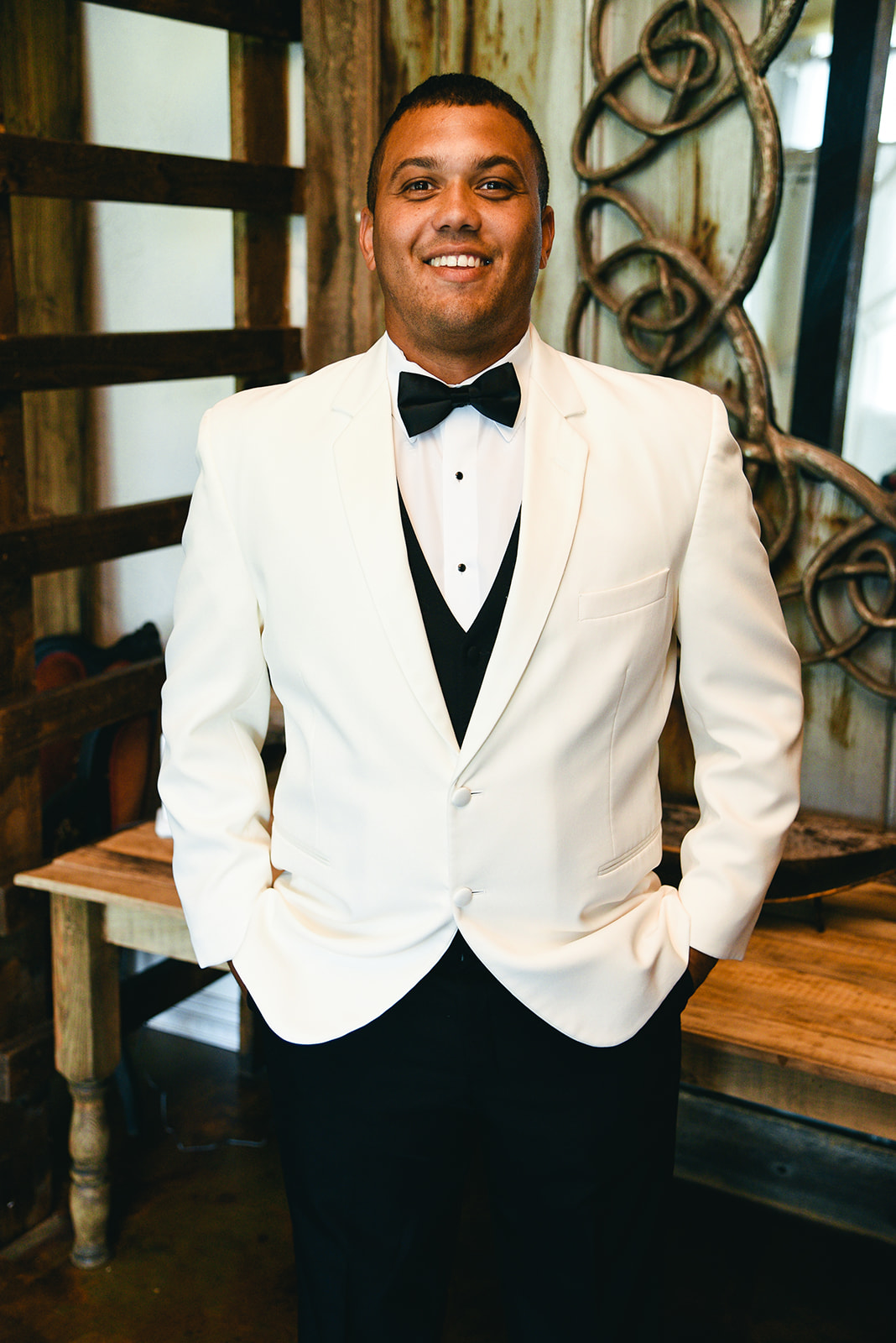 White tuxedo jacket: Elegant Cason Cove Wedding featured on Nashville Bride Guide