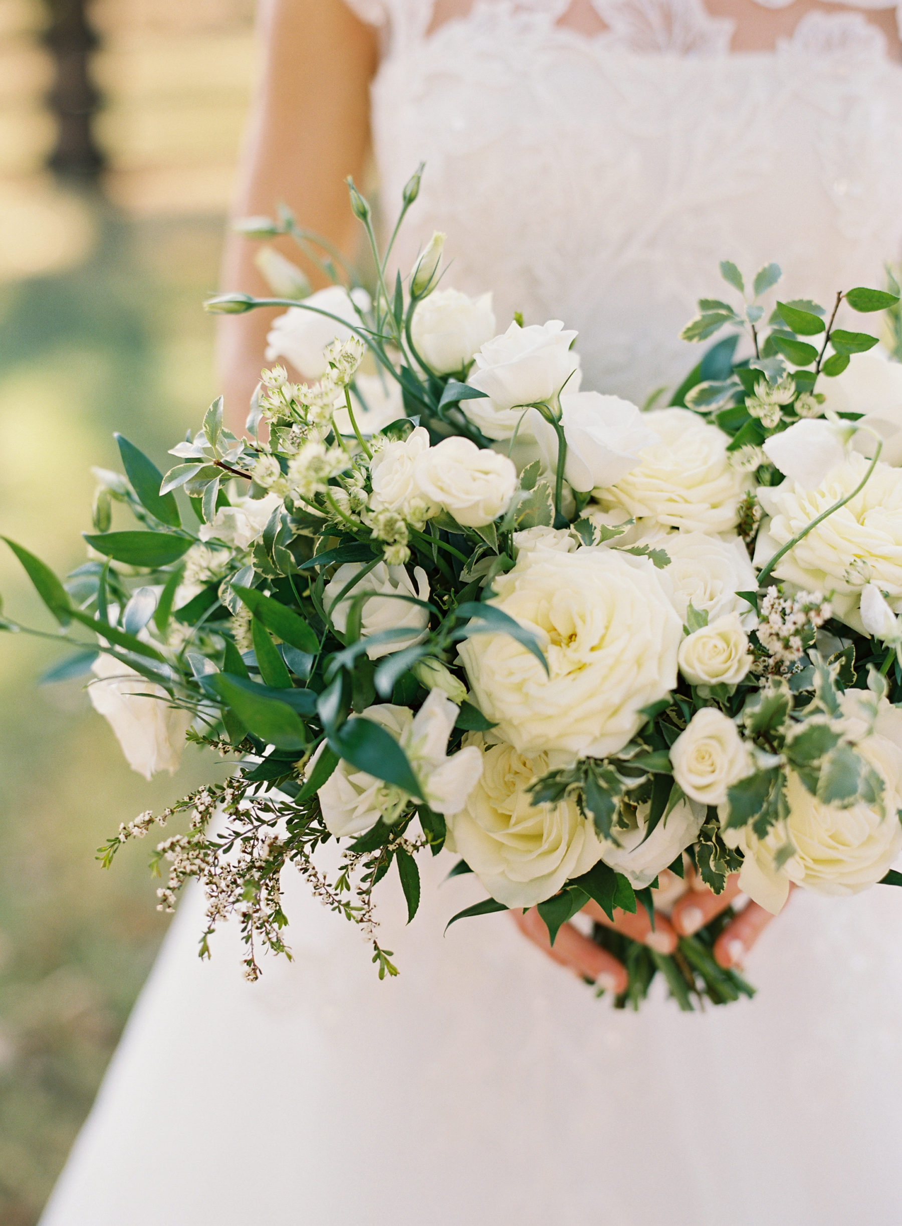 White and greenery wedding bouquet by Wildflowers LLC for fall Nashville wedding