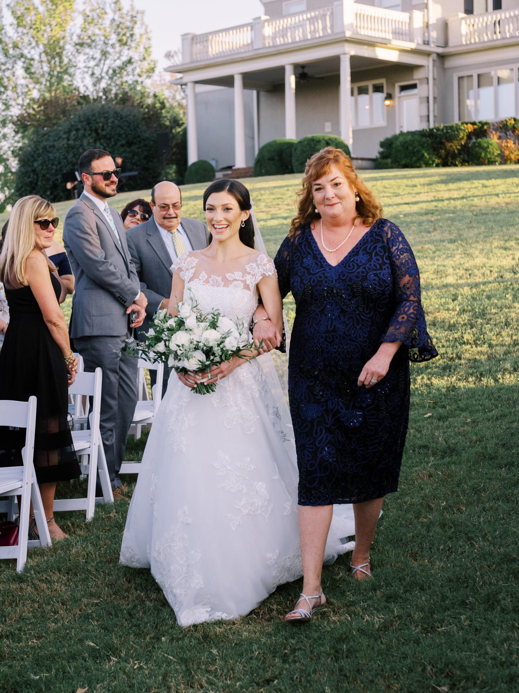 Bride walking down the aisle at Autumn Crest Farm wedding