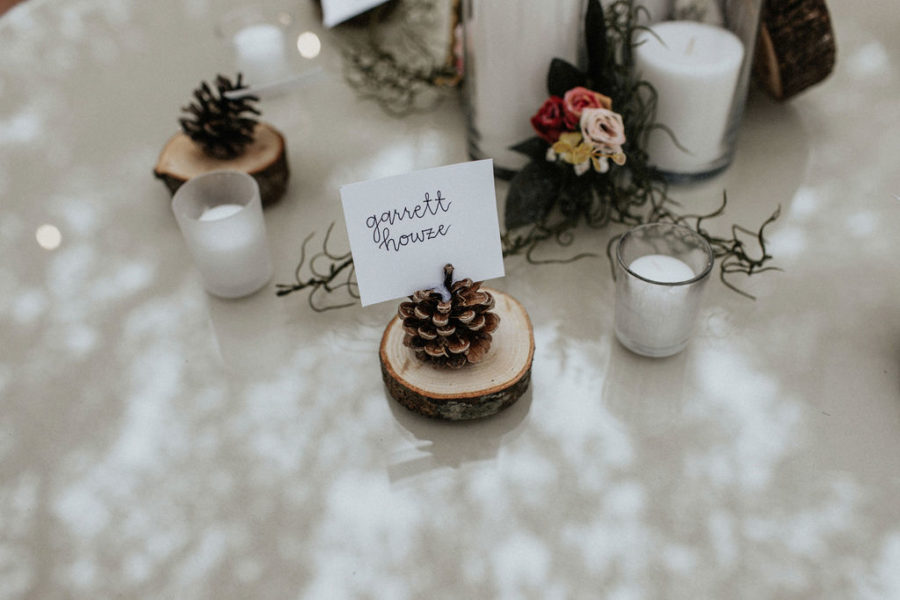 Pine cone wedding escort cards: Magical Winter Wedding by Meghan Melia Photography featured on Nashville Bride Guide!
