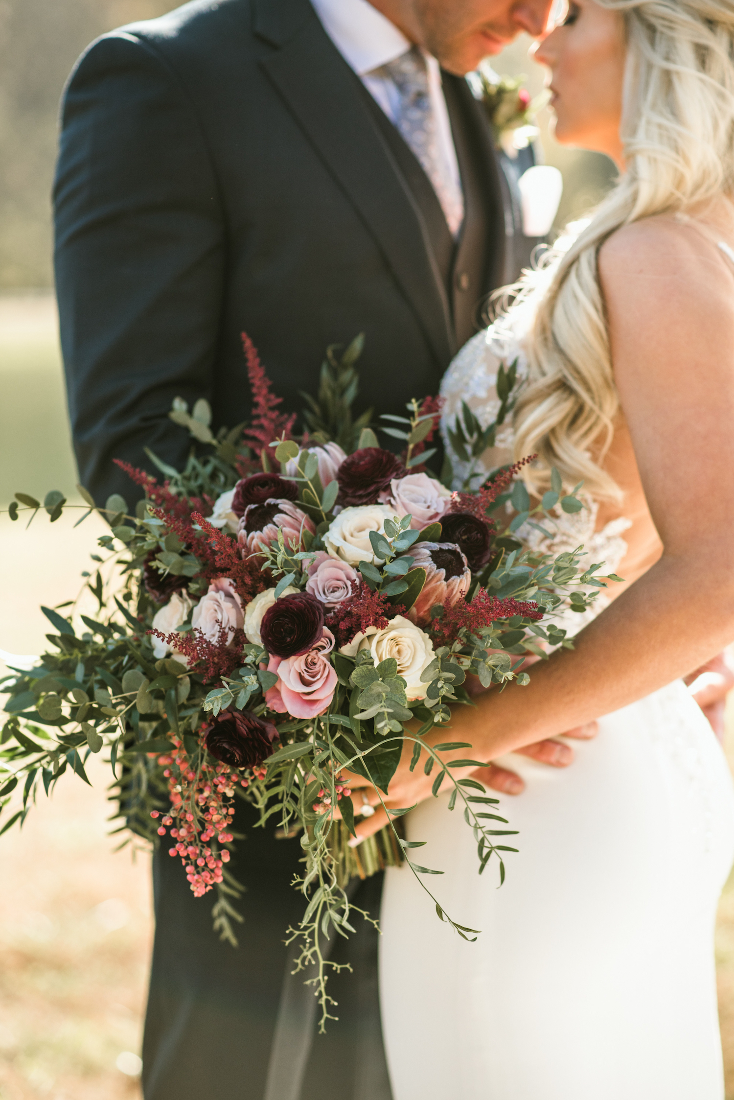 Burgundy and White Wedding Bouquet: Upscale Marble Graystone Quarry Wedding featured on Nashville Bride Guide