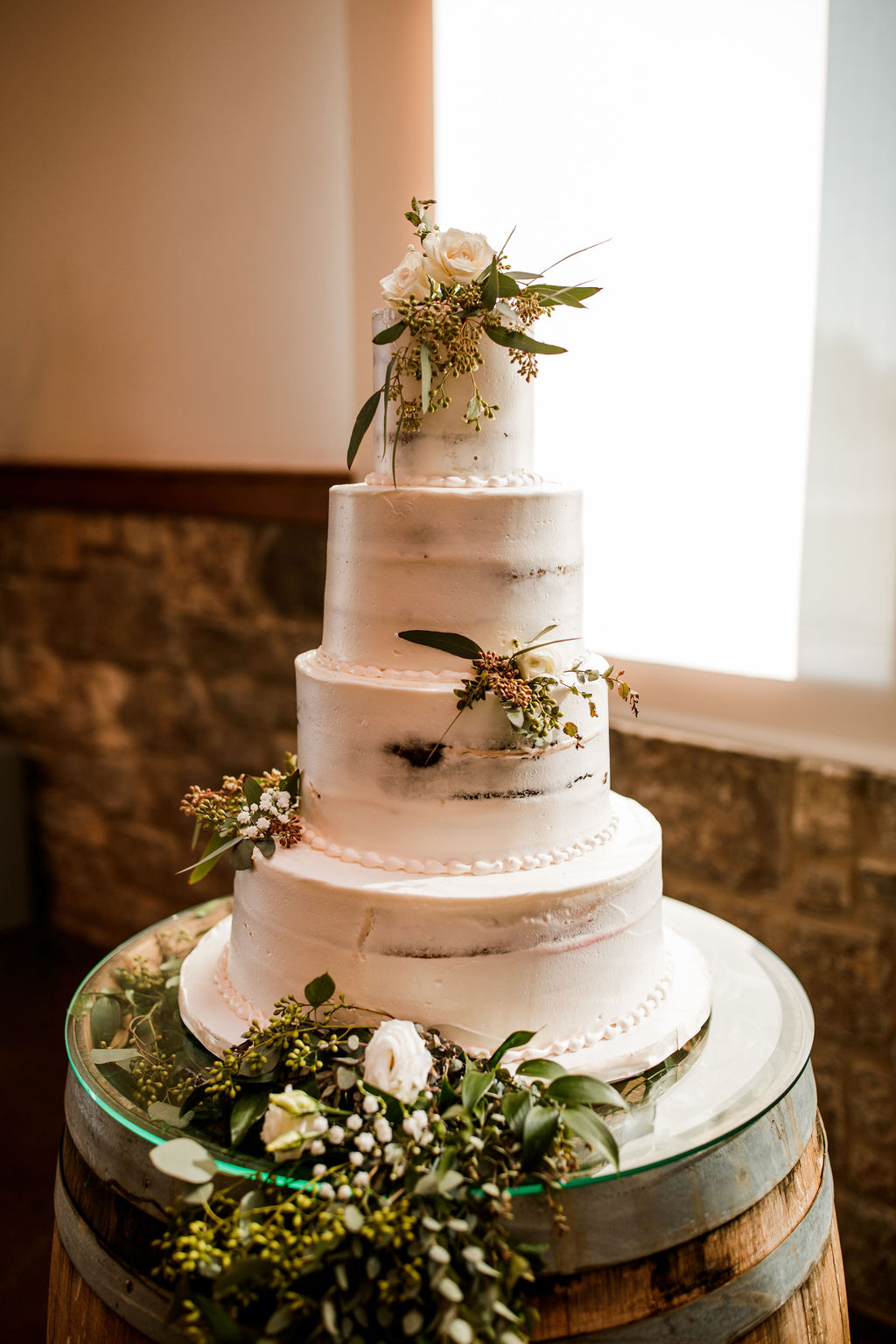 White and greenery wedding cake: Beautiful Graystone Quarry Wedding featured on Nashville Bride Guide!