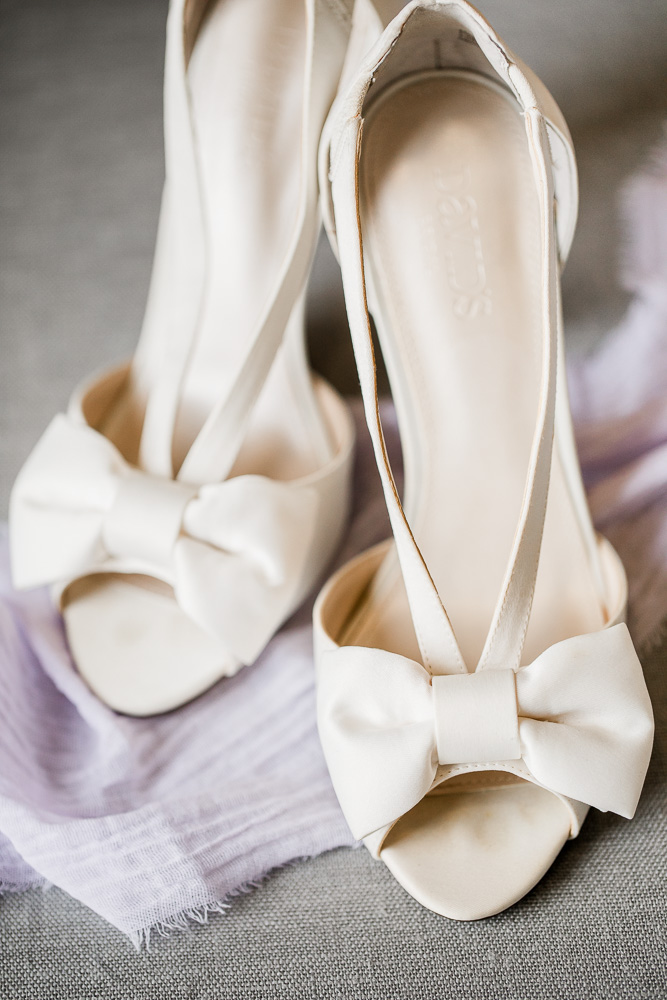 Ivory Bow Wedding Shoes captured by Amanda May Photos featured on Nashville Bride Guide