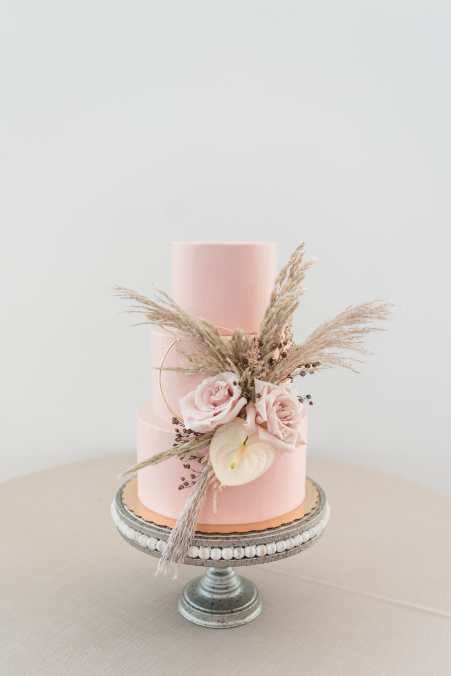 Pink Wedding Cake with Pampas Grass: Organic Eco-Friendly Wedding Styled Shoot featured on Nashville Bride Guide