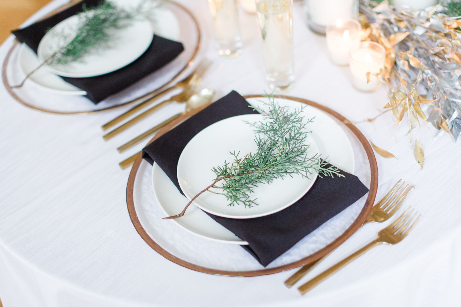 Evergreen wedding table decor: Classic, Yet Modern New Years Eve Wedding Inspiration featured on Nashville Bride Guide