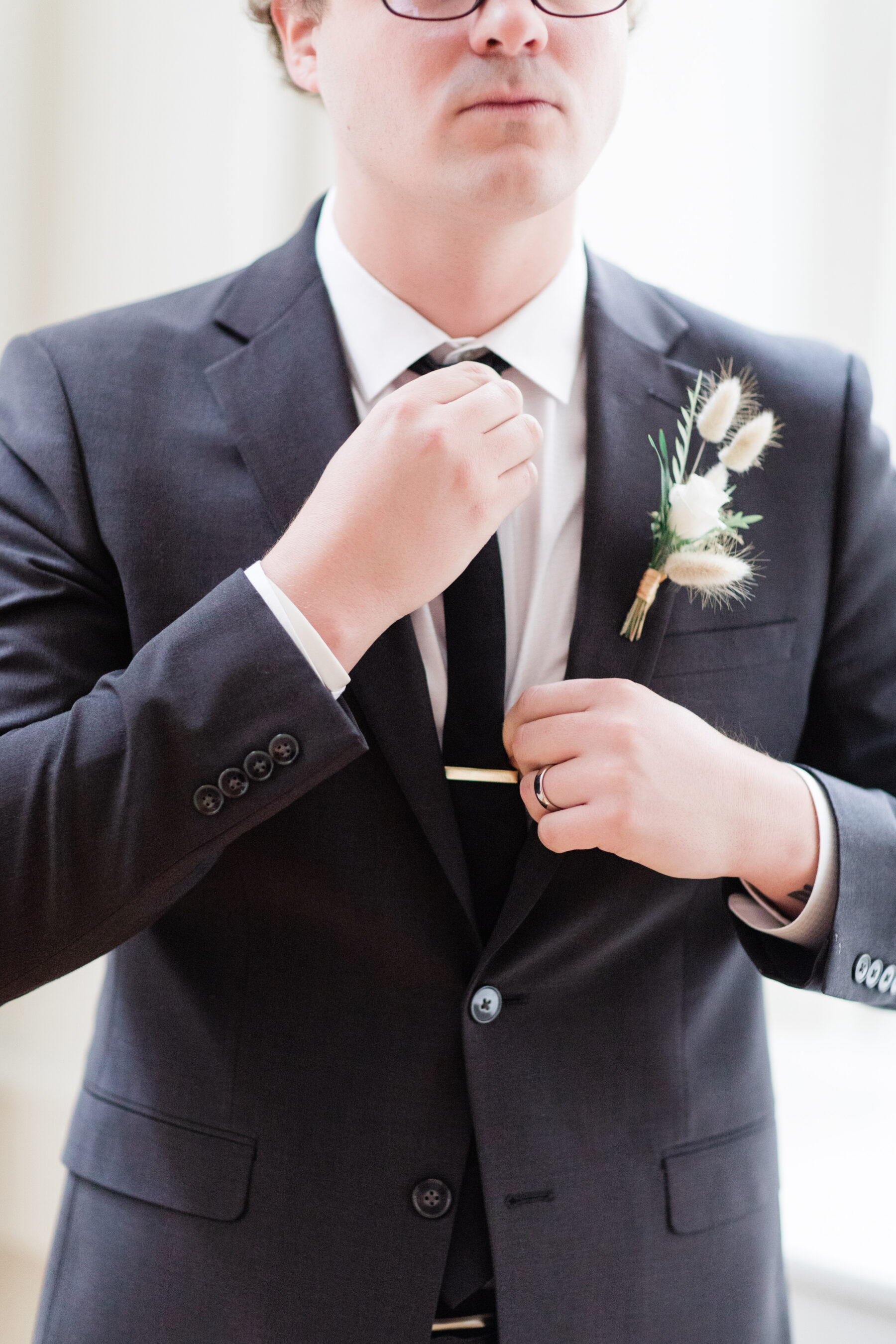 Wedding boutonniere: Classic, Yet Modern New Years Eve Wedding Inspiration featured on Nashville Bride Guide
