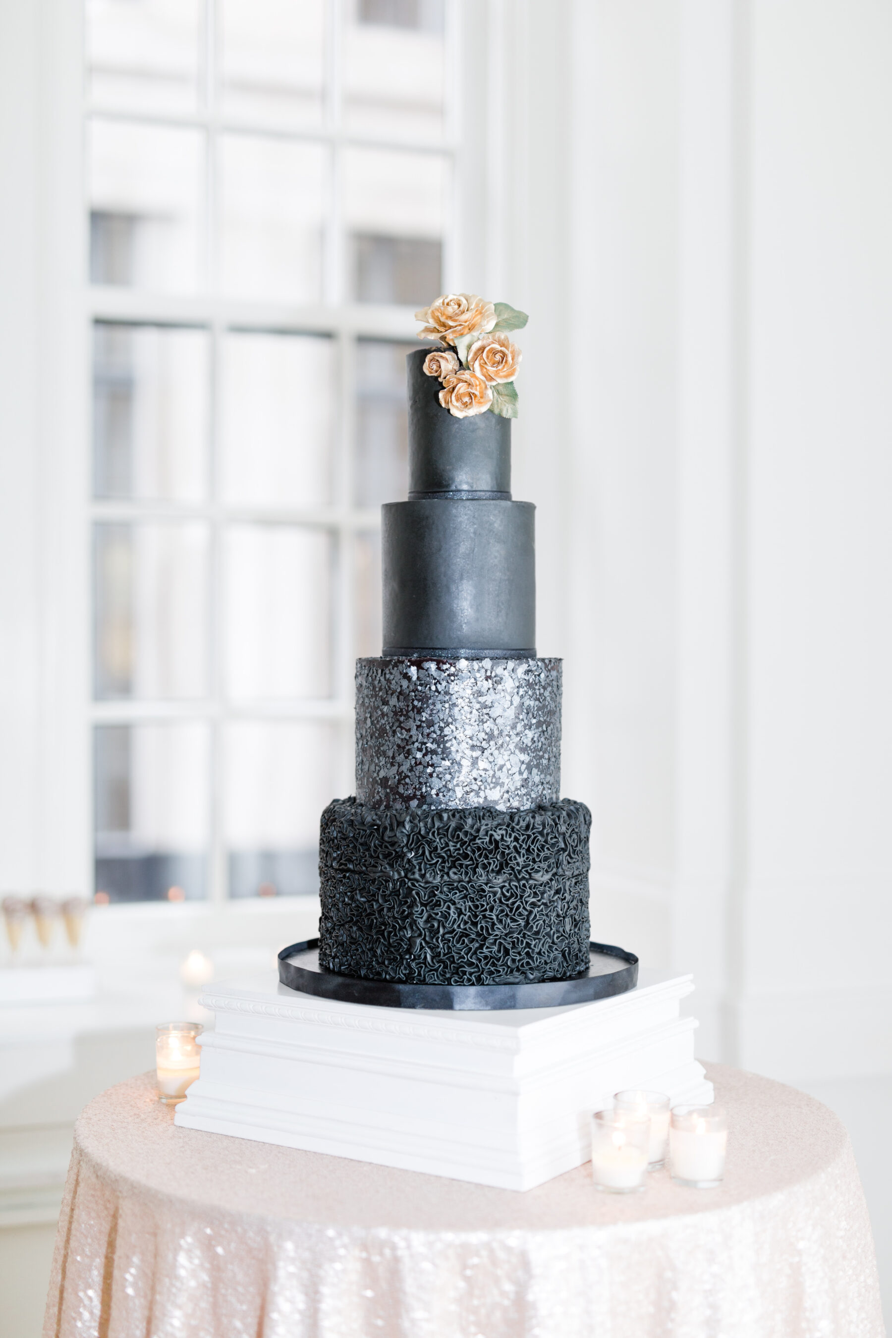 Sparkly black wedding cake: Classic, Yet Modern New Years Eve Wedding Inspiration featured on Nashville Bride Guide