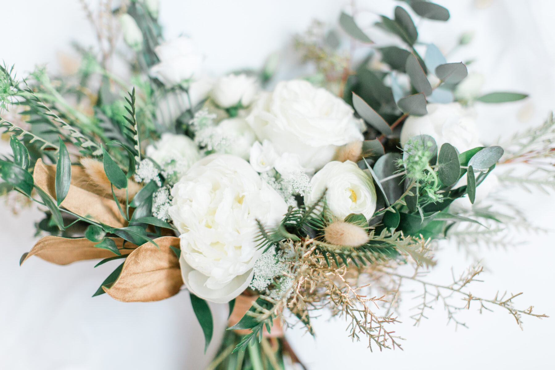 White and greenery wedding table decor: Classic, Yet Modern New Years Eve Wedding Inspiration featured on Nashville Bride Guide