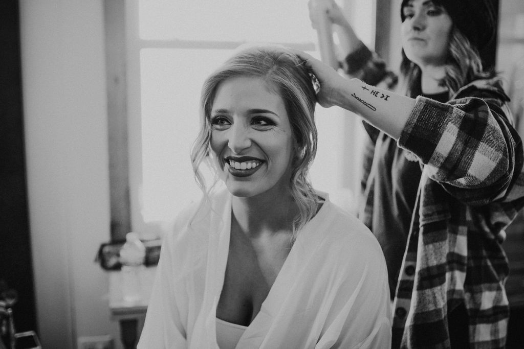 Bride getting ready: Boho Barn Wedding by Melissa Marie Floral Designs