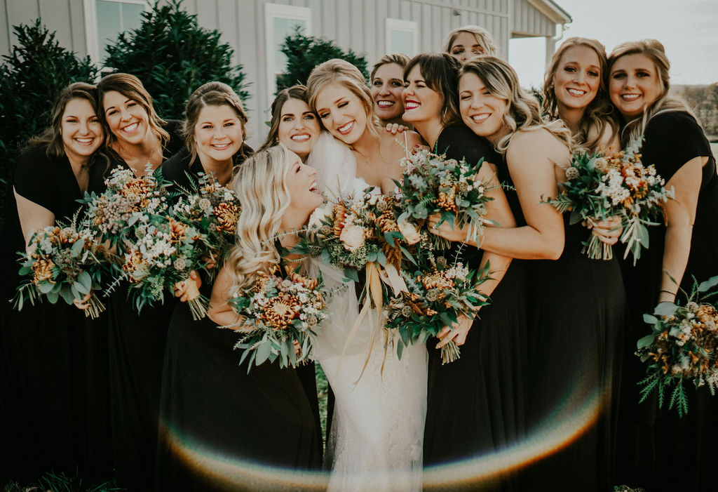 Bride with bridesmaid: Boho Barn Wedding by Melissa Marie Floral Designs