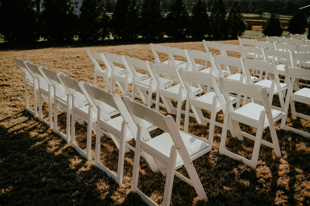 Outdoor wedding ceremony seating: Boho Barn Wedding by Melissa Marie Floral Designs