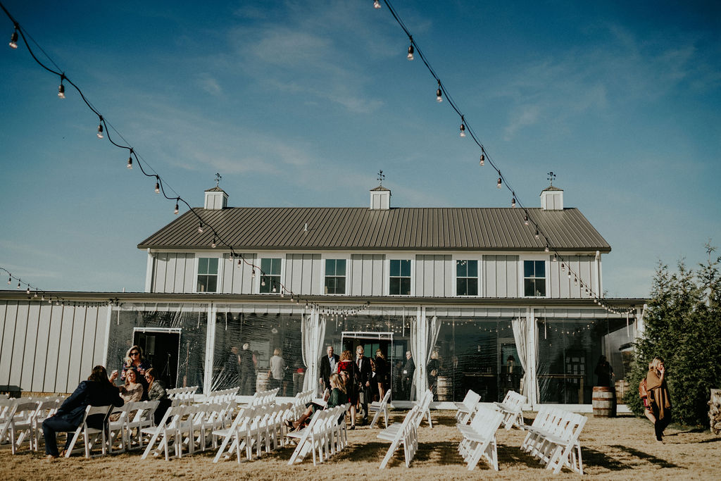 Outdoor barn wedding: Boho Barn Wedding by Melissa Marie Floral Designs