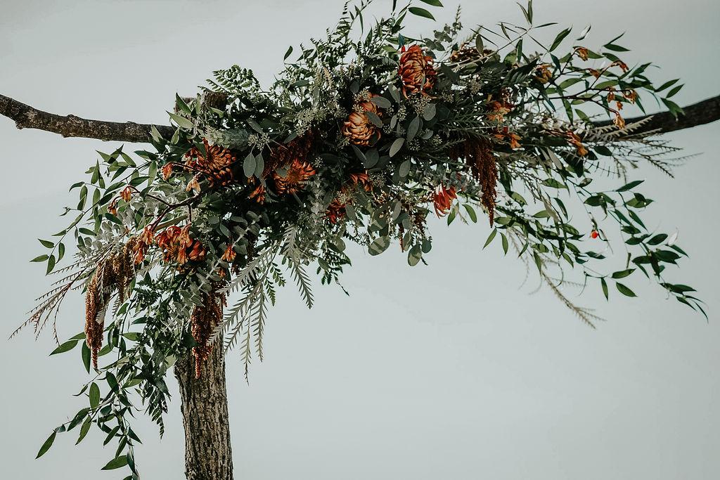 Wedding ceremony floral arch: Boho Barn Wedding by Melissa Marie Floral Designs