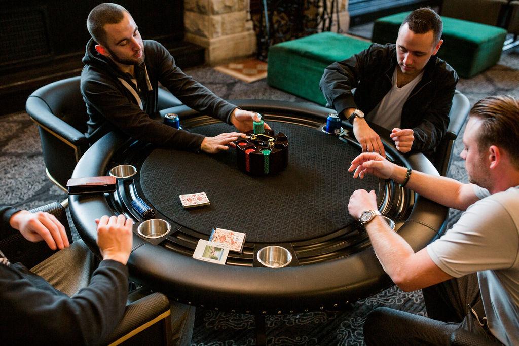 Groomsmen playing poker: Lavish Union Station Hotel Wedding featured on Nashville Bride Guide