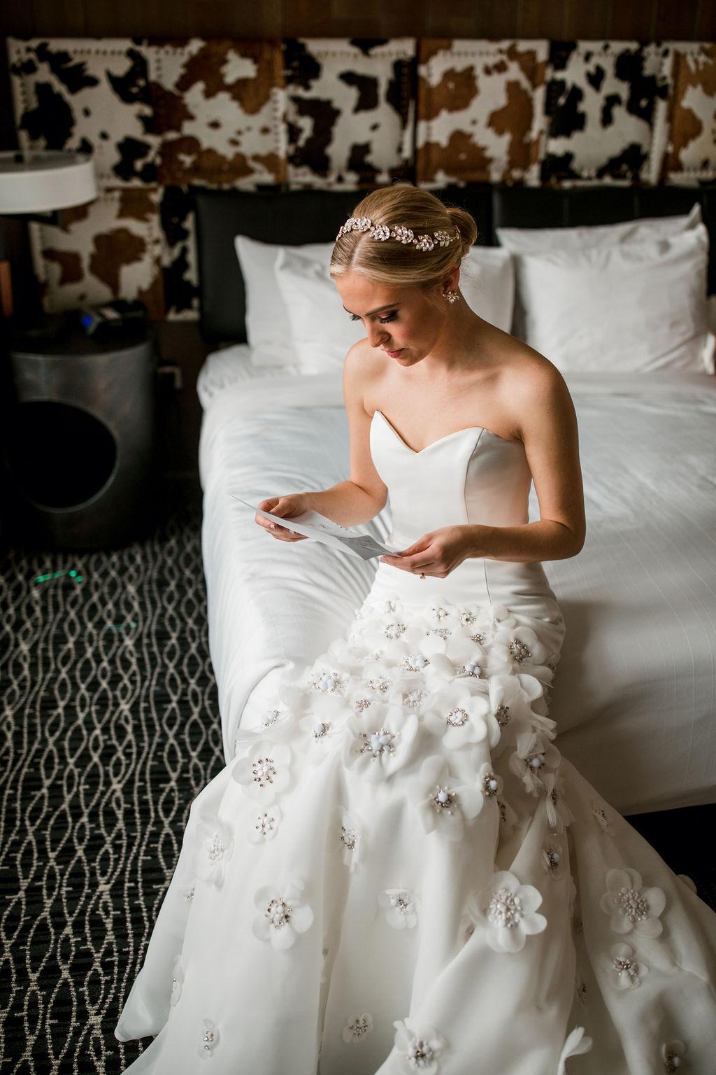 Bride reading letter from groom: Lavish Union Station Hotel Wedding featured on Nashville Bride Guide