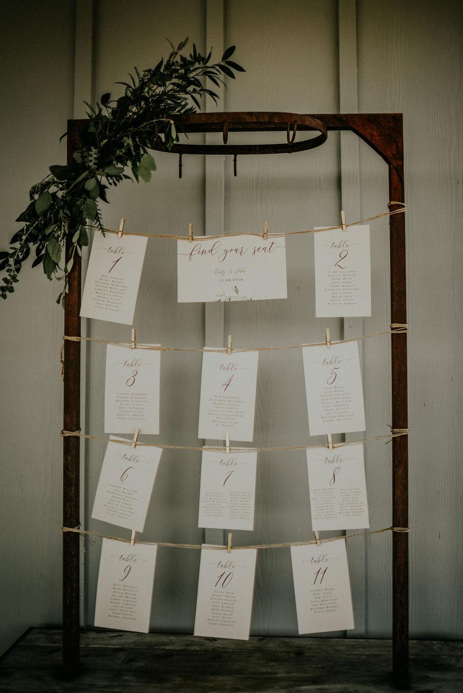 Wedding escort card display: Boho Barn Wedding by Melissa Marie Floral Designs