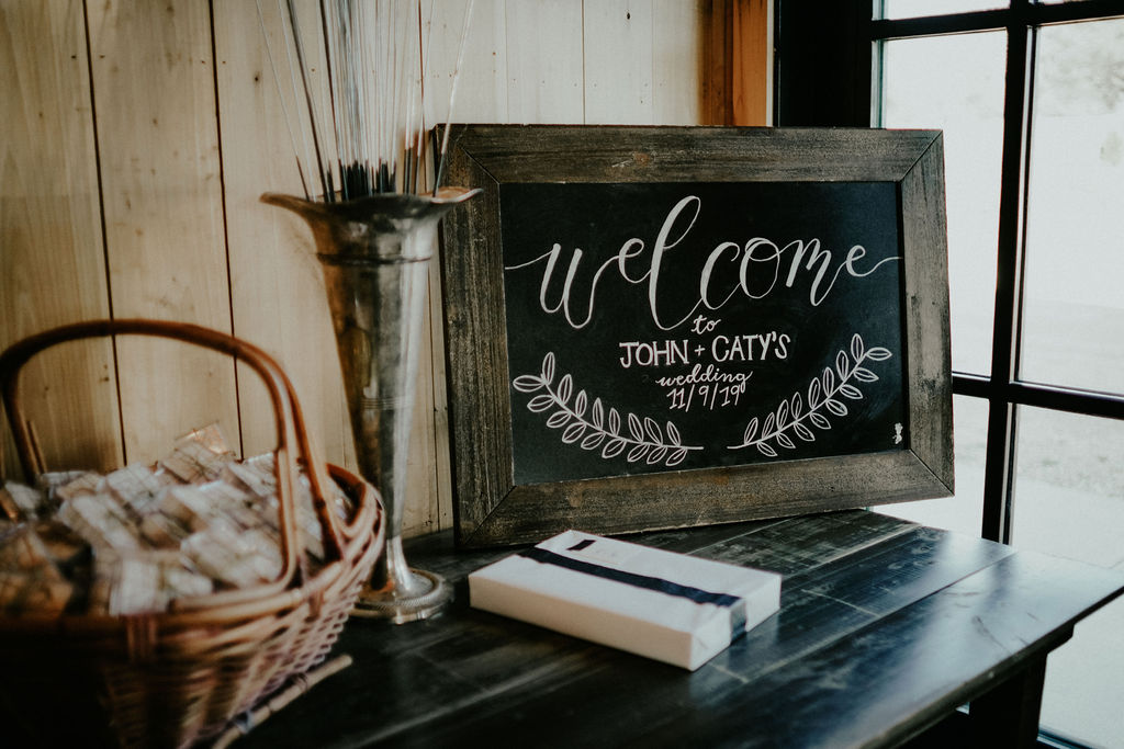 Chalkboard wedding welcome sign: Boho Barn Wedding by Melissa Marie Floral Designs